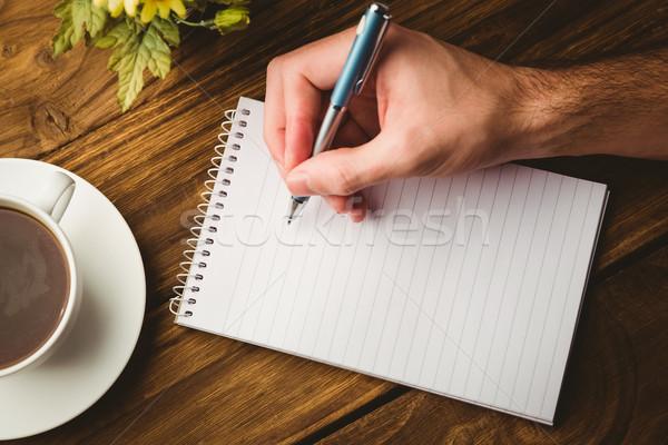 Hand writing on the notepad Stock photo © wavebreak_media