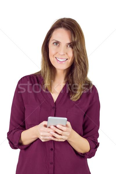 Pretty brunette sending a text message Stock photo © wavebreak_media