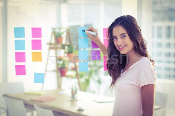 Smiling women writing photo editor Stock photo © wavebreak_media