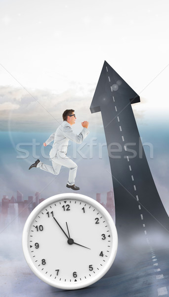 Composite image of geeky happy businessman running mid air Stock photo © wavebreak_media