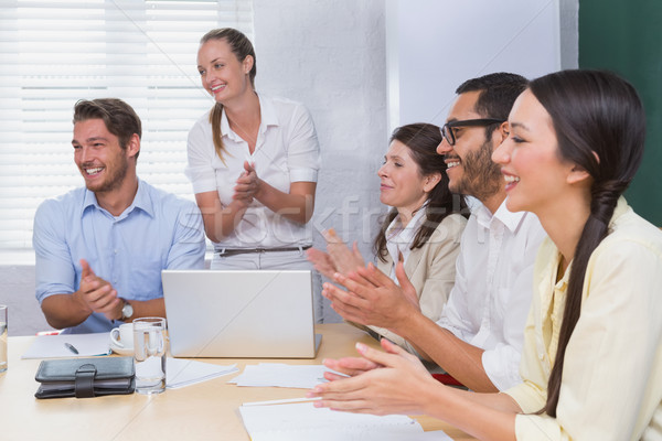 Smiling business people clapping during a meeting Stock photo © wavebreak_media