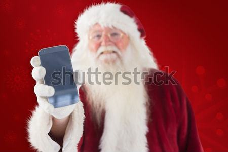 Composite image of santa claus shows a smartphone Stock photo © wavebreak_media