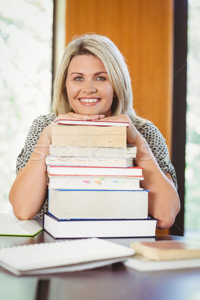 Smiling mature student with stack of books Stock photo © wavebreak_media
