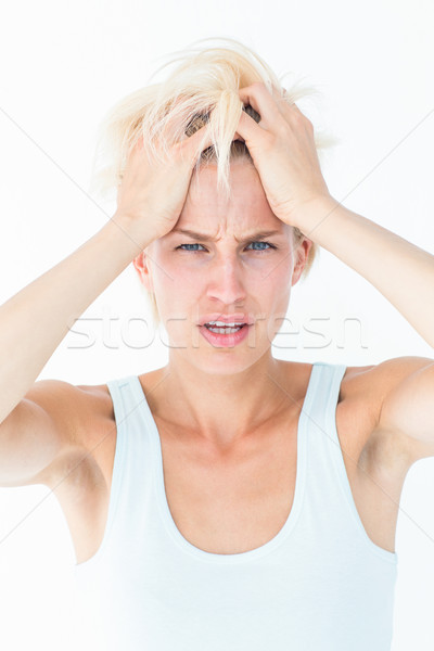Sad blonde woman with head pain holding her head  Stock photo © wavebreak_media