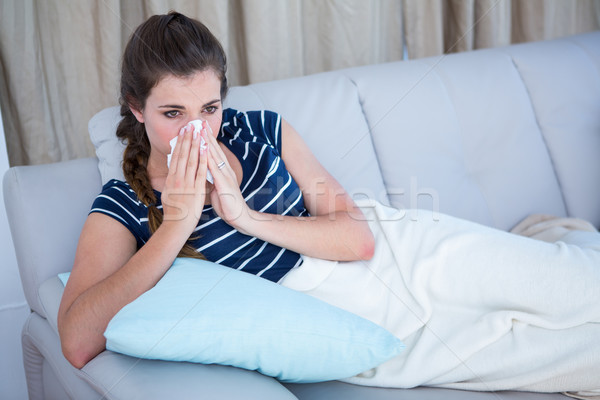 Doente mulher assoar o nariz sofá casa sala de estar Foto stock © wavebreak_media