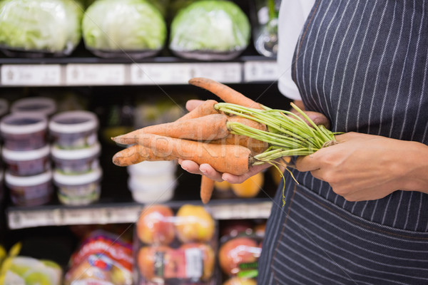 Close up view of woman showing carrot  Stock photo © wavebreak_media