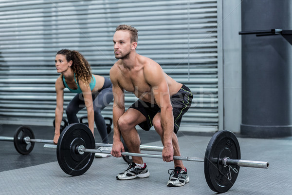 Musculaire couple poids ensemble crossfit Photo stock © wavebreak_media