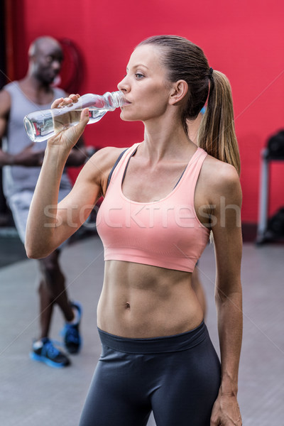 A muscular woman drinking a water  Stock photo © wavebreak_media