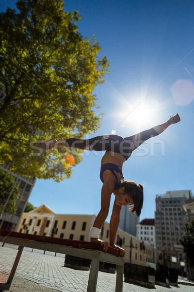 спортивный женщину стойка на руках скамейке город Сток-фото © wavebreak_media