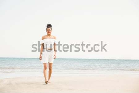 Stylish woman walking on the sand Stock photo © wavebreak_media