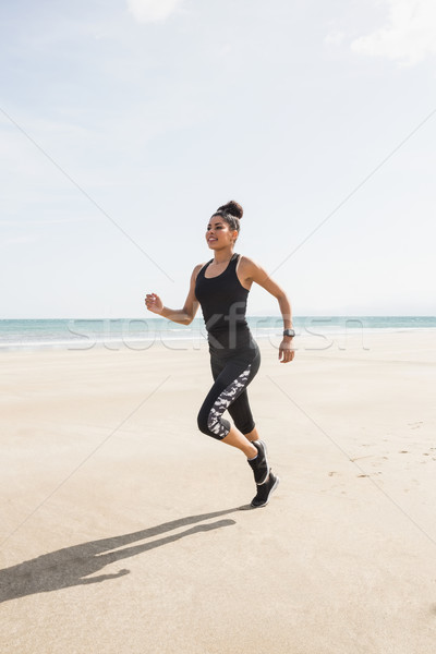 Fit woman jogging on the sand Stock photo © wavebreak_media
