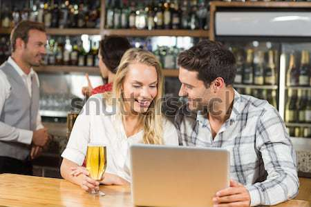 улыбаясь пару таблетка кофейня Сток-фото © wavebreak_media
