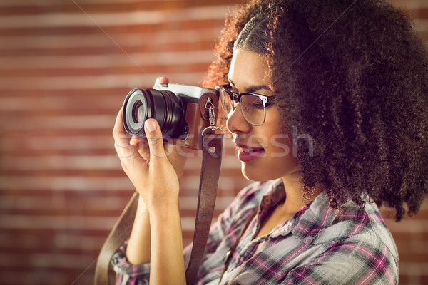 Attractive hipster photographing with camera Stock photo © wavebreak_media