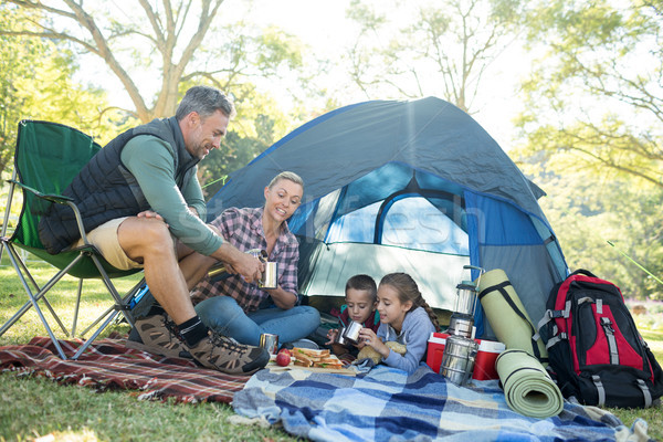 Family having snacks and coffee outside the tent Stock photo © wavebreak_media