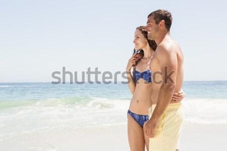 Widok z boku człowiek sympatia stałego plaży Zdjęcia stock © wavebreak_media