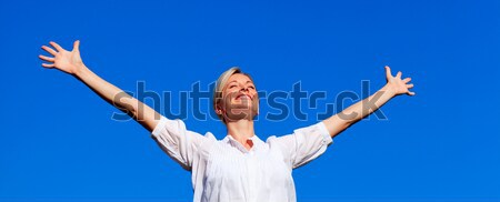 Low angle view of man with arms outstretched Stock photo © wavebreak_media