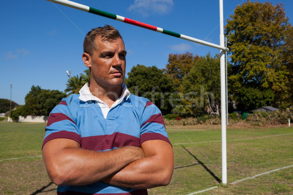Thoughtful rugby player at playing field on sunny day Stock photo © wavebreak_media