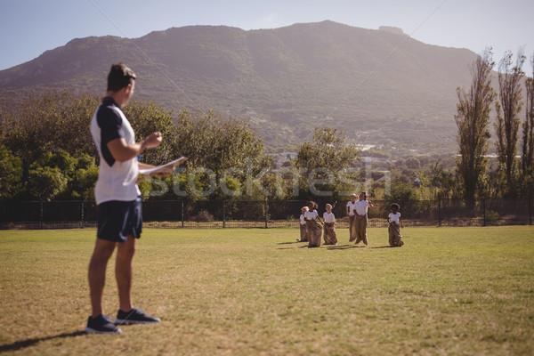 тренер школьницы мешок гонка парка Сток-фото © wavebreak_media