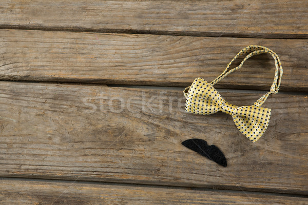 High angle view of mustache with bow tie on table Stock photo © wavebreak_media