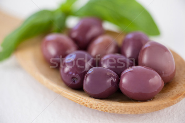 Close up of brown olives in spoon Stock photo © wavebreak_media