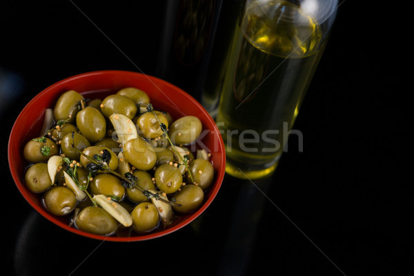 Close-up of marinated olives with olive oil and balsamic vinegar bottle Stock photo © wavebreak_media