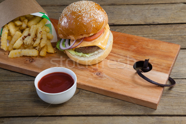 Stock photo: Hamburger, french fries and tomato sauce on table