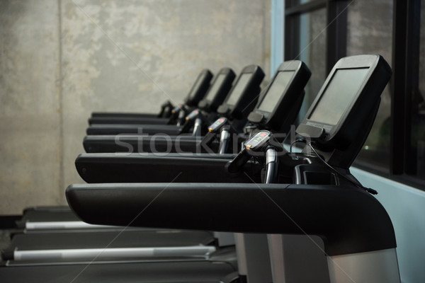 Treadmills in row at empty gym Stock photo © wavebreak_media