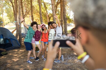 Stock photo: Happy friends hitchhiking on road