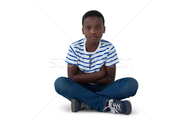 Stock photo: Portrait of sad boy sitting on floor