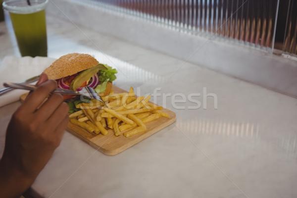стороны женщину картофель фри кафе Burger борьбе Сток-фото © wavebreak_media