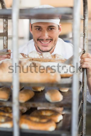 Portrait of smiling young man holding eyeglasses standing against female friends at coffee shop Stock photo © wavebreak_media