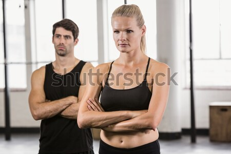couple holding dumbbells looking at camera  Stock photo © wavebreak_media