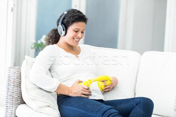 счастливым женщину наушники живота голову беременная женщина Сток-фото © wavebreak_media