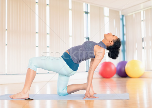 Woman performing stretching exercise in the gym Stock photo © wavebreak_media