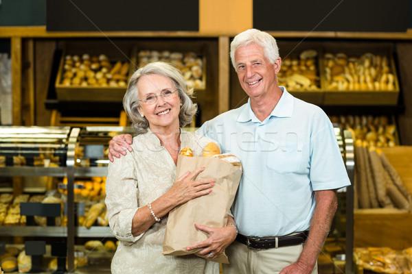 Glimlachend bakkerij zak store Stockfoto © wavebreak_media