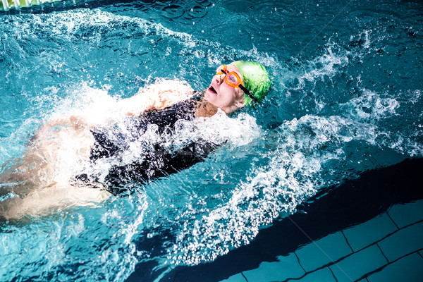 Fit woman swimming with swimming hat Stock photo © wavebreak_media