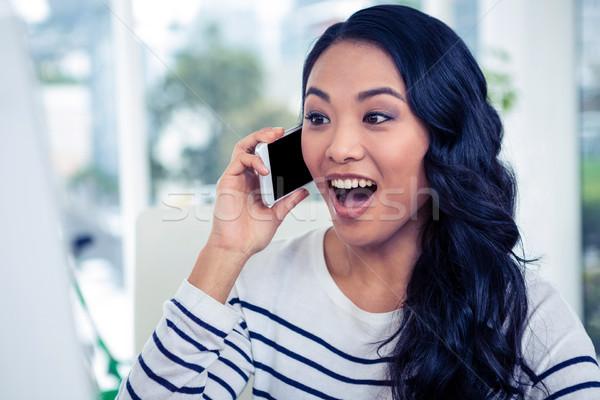 Meglepődött ázsiai nő telefonál hívás iroda üzlet Stock fotó © wavebreak_media