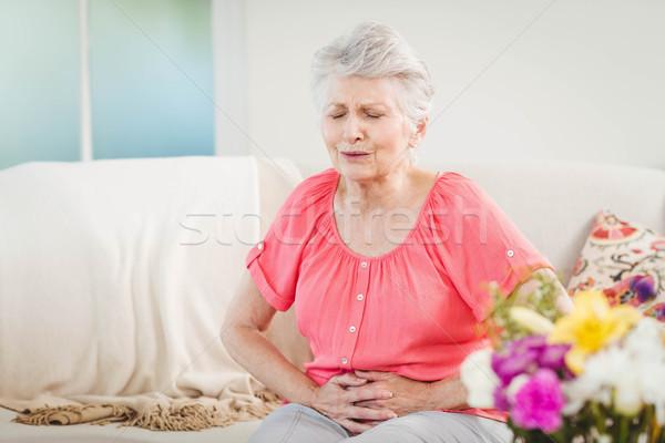 Idős nő szenvedés gyomor fájdalom otthon Stock fotó © wavebreak_media