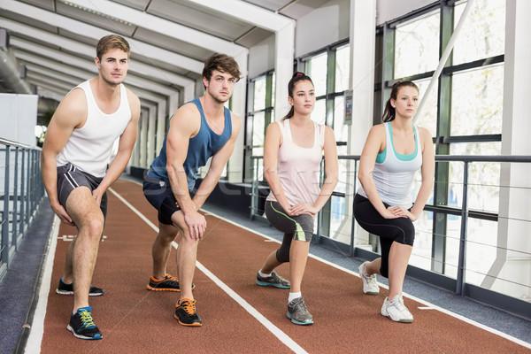 Négy sportos nők férfiak nyújtás fut Stock fotó © wavebreak_media