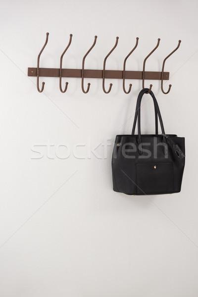 Fekete táska akasztás kampó fal divat Stock fotó © wavebreak_media