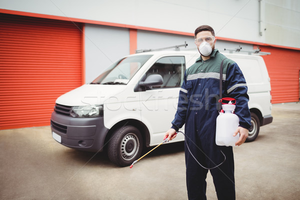 Handyman with insecticide standing Stock photo © wavebreak_media