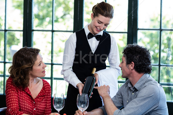 Couple selecting a bottle of wine Stock photo © wavebreak_media