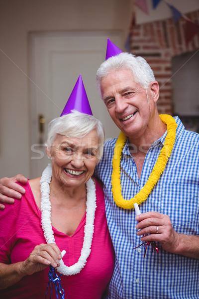 Retrato sorridente casal de idosos festa chifre Foto stock © wavebreak_media