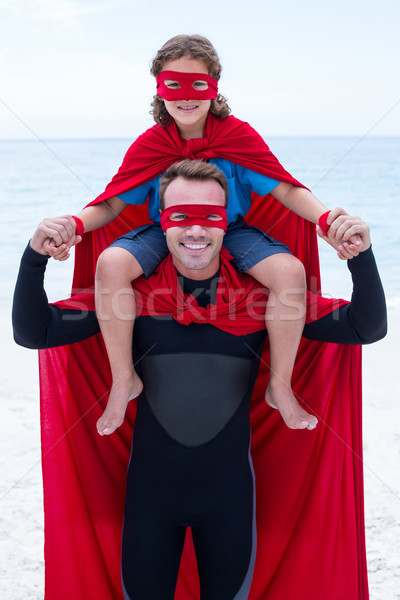 Happy father in superhero costume carrying son on shoulder Stock photo © wavebreak_media