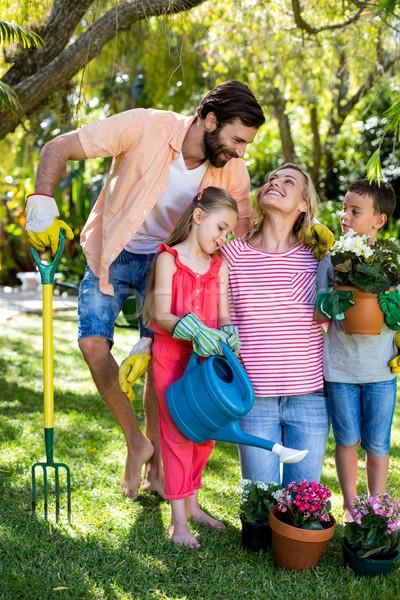 Parents with children gardening in yard  Stock photo © wavebreak_media