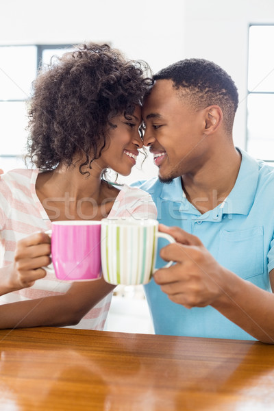 Happy couple toasting coffee mug Stock photo © wavebreak_media