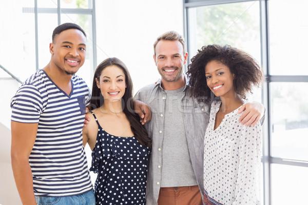 Gens d'affaires regarder caméra souriant portrait bureau Photo stock © wavebreak_media