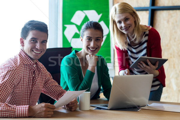 Colleague sitting at their desk Stock photo © wavebreak_media