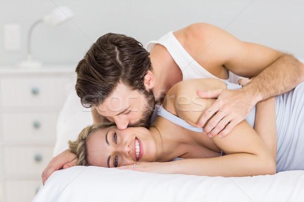 Romantikus pár átkarol ágy hálószoba nő Stock fotó © wavebreak_media