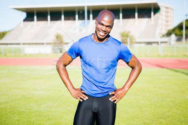 Portrait of a happy athlete Stock photo © wavebreak_media